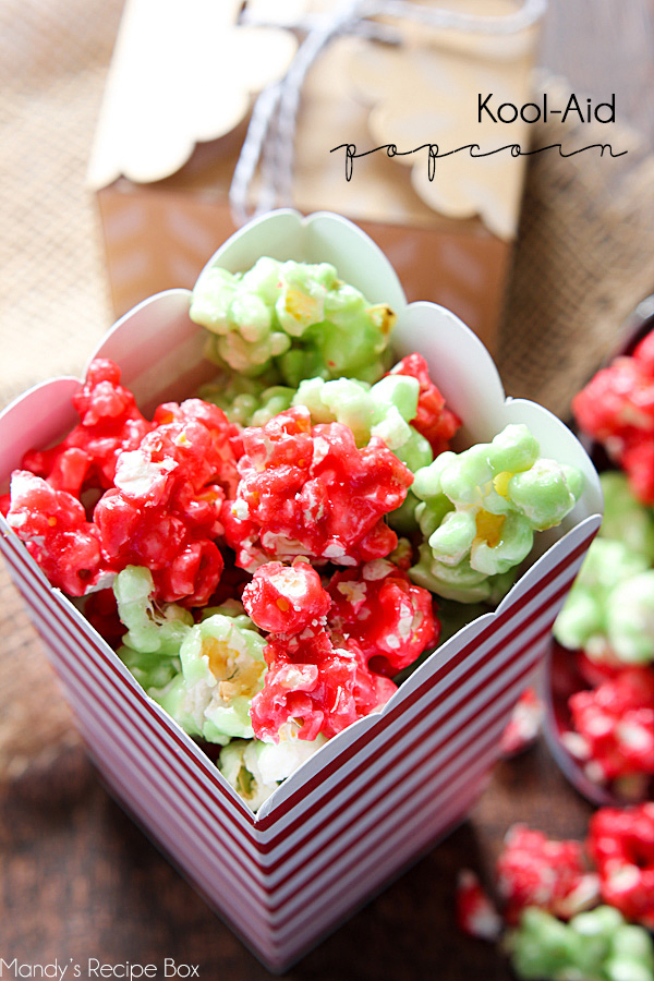 Kool-Aid Popcorn - this is a fun, easy treat to make for and with your kids! The red and green colors are perfect for the holiday season. Kool-Aid has so many flavors the possibilities are endless. Blue for frozen themed popcorn, red and pink for Valentines's Day, green for St. Patrick's day or several light colors to celebrate spring. Popcorn balls would also be fun to make.